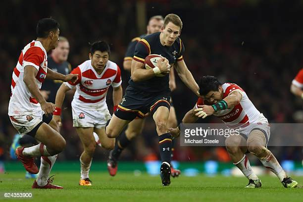 Liam Williams of Wales bursts between Timothy Lafaele and Harumichi Tatekawa of Japan during the International match between Wales and Japan at the...