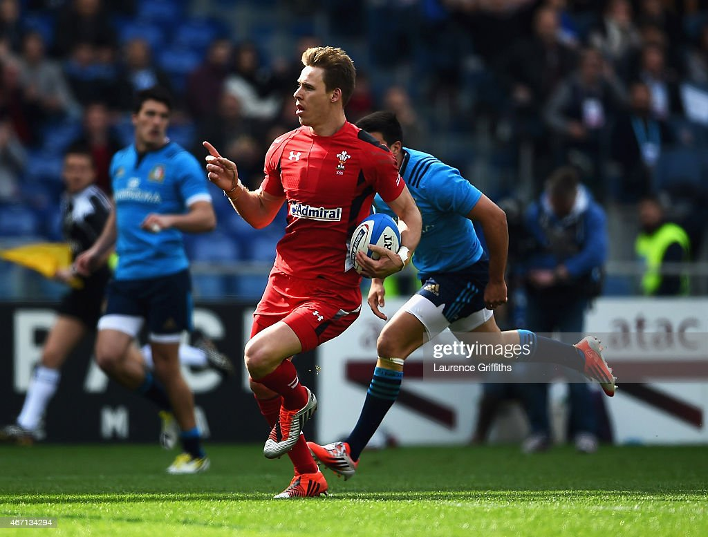 <a gi-track='captionPersonalityLinkClicked' href=/galleries/search?phrase=Liam+Williams&family=editorial&specificpeople=7852399 ng-click='$event.stopPropagation()'>Liam Williams</a> of Wales celebrates scoring his try during the RBS 6 Nations match between Italy and Wales at Stadio Olimpico on March 21, 2015 in Rome, Italy.