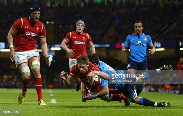 Liam Williams of Wales crashes through David Odiete of Italy to score his team's sixth try during the RBS Six Nations match between Wales and Italy...