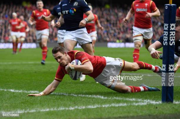 Liam Williams of Wales dives past Stuart Hogg of Scotland to score the opening try during the RBS Six Nations match between Scotland and Wales at...