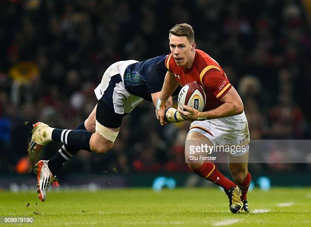 Liam Williams of Wales goes past the challenge from Tommy Seymour of Scotland during the RBS Six Nations match between Wales and Scotland at the...