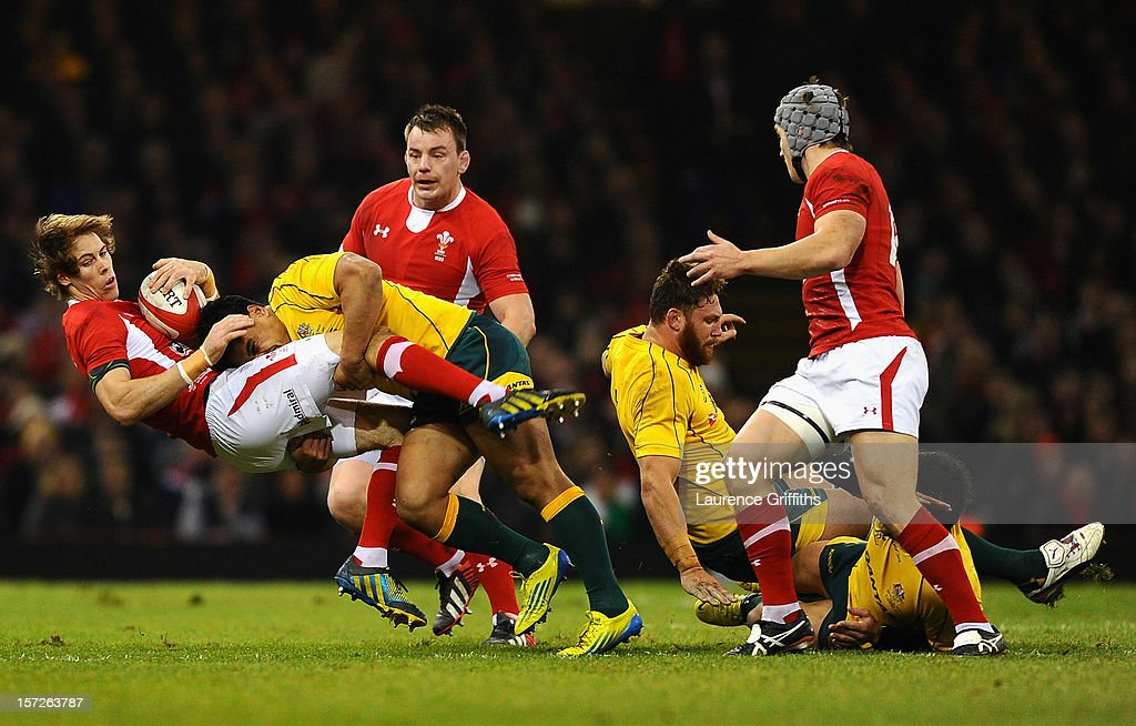 Liam Williams of Wales is tackled by Ben Tapuai of Australia during the International match between Wales and Australia at Millennium Stadium on December 1, 2012 in Cardiff, Wales.