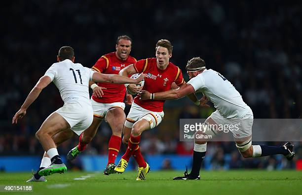 Liam Williams of Wales is tackled by Jonny May and Geoff Parling of England during the 2015 Rugby World Cup Pool A match between England and Wales at...