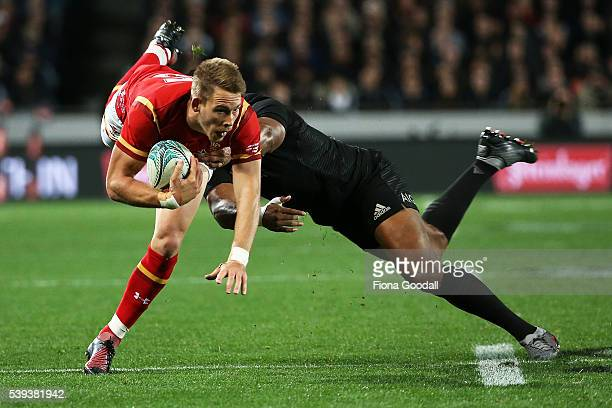 Liam Williams of Wales is tackled by Julian Savea during the International Test match between the New Zealand All Blacks and Wales at Eden Park on...
