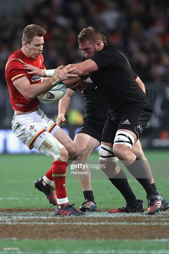 Liam Williams (L) of Wales is tackled by Luke Romano of the All Blacks (R) during the International Test match between the New Zealand All Blacks and Wales at Forsyth Barr Stadium on June 25, 2016 in Dunedin, New Zealand.