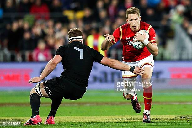 Liam Williams of Wales is tackled by Sam Cane of the All Blacks during the International Test match between the New Zealand All Blacks and Wales at...