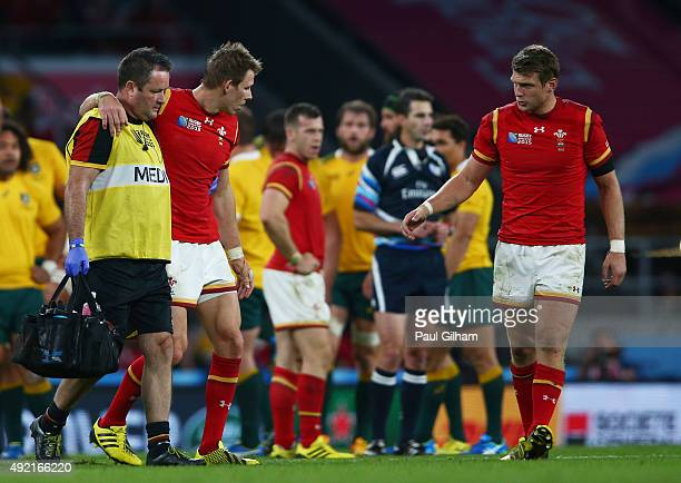 Liam Williams of Wales leaves the field injured consoled by Dan Biggar during the 2015 Rugby World Cup Pool A match between Australia and Wales at...