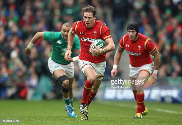 Liam Williams of Wales makes a break during the RBS Six Nations match between Ireland and Wales at the Aviva Stadium on February 7 2016 in Dublin...