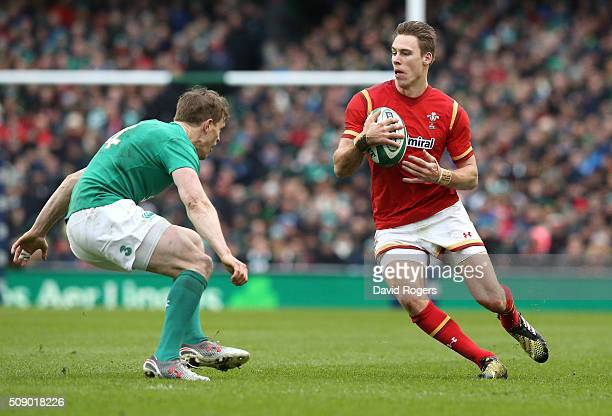 Liam Williams of Wales takes on Andrew Trimble during the RBS Six Nations match between Ireland and Wales at the Aviva Stadium on February 7 2016 in...