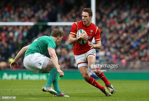 Liam Williams of Wales takes on Andrew Trimble of Ireland during the RBS Six Nations match between Ireland and Wales at the Aviva Stadium on February...