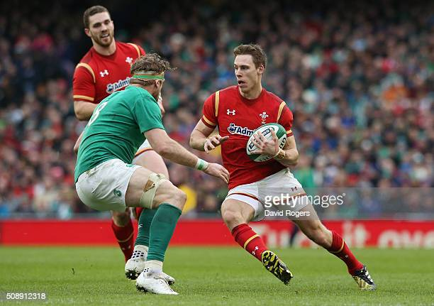 Liam Williams of Wales takes on Jamie Heaslip of Ireland during the RBS Six Nations match between Ireland and Wales at the Aviva Stadium on February...