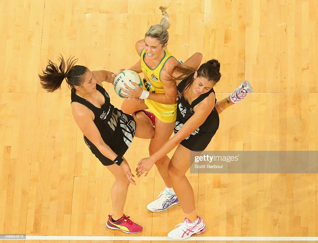 Liana Leota and Ameliaranne Wells of the Silver Ferns and Julie Corletto of the Diamonds compete for the ball during the International Test match...