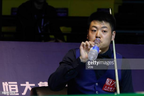 Liang Wenbo of China drinks water during a qualifying match against Ian Burns of England on day one of Evergrande 2017 World Snooker China Champion...