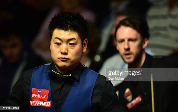 Liang Wenbo of China looks on during his first round match against Judd Trump of England on day six of the World Snooker Championship at The Crucible...
