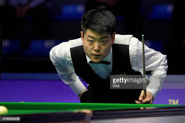 Liang Wenbo of China looks on during the match against Mark Selby of England on day four of the 2014 Snooker Haikou World Open on March 13 2014 in...