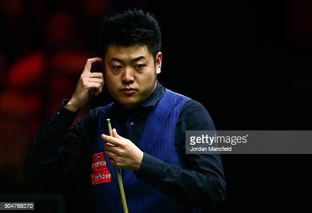 Liang Wenbo of China looks on in his first round match against John Higgins of Scotland during Day Four of the Dafabet Masters at Alexandra Palace on...