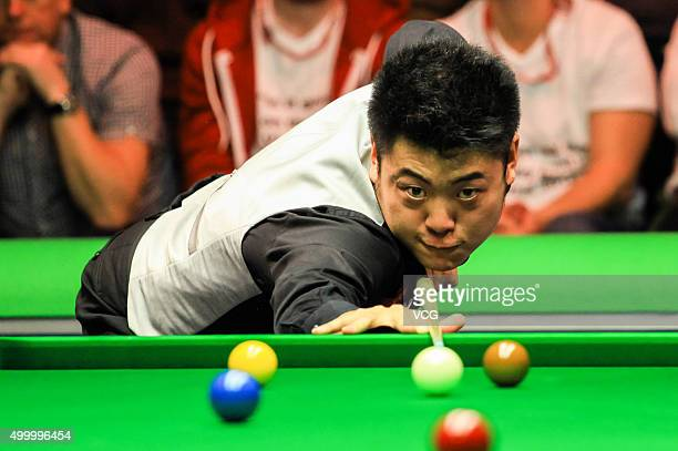 Liang Wenbo of China plays a shot against Marco Fu of Hong Kong in quarterfinal match on day ten of Betway UK Championship at Barbican Centre on...