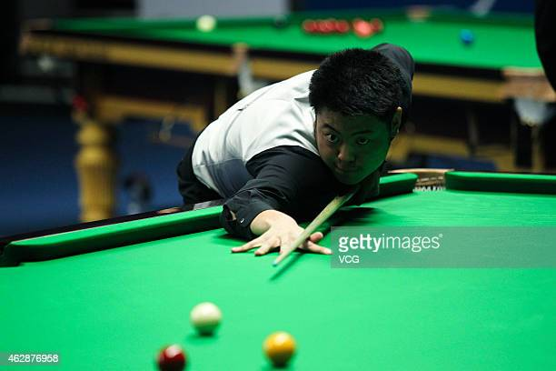 Liang Wenbo of China plays a shot against Ryan Day of Great Britain on day three of the 2015 German Masters at Tempodrom on February 6 2015 in Berlin...