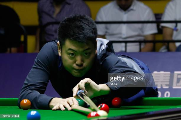 Liang Wenbo of China plays a shot during a qualifying match against Ian Burns of England on day one of Evergrande 2017 World Snooker China Champion...