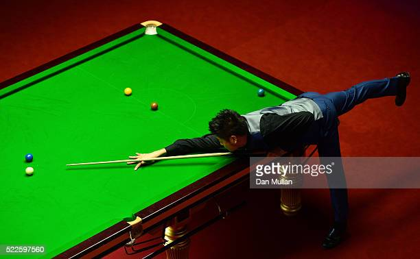 Liang Wenbo of China plays a shot during his first round match against Judd Trump of England on day 5 of the World Snooker Championship at The...