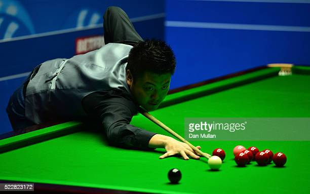 Liang Wenbo of China plays a shot during his first round match against Judd Trump of England on day six of the World Snooker Championship at The...