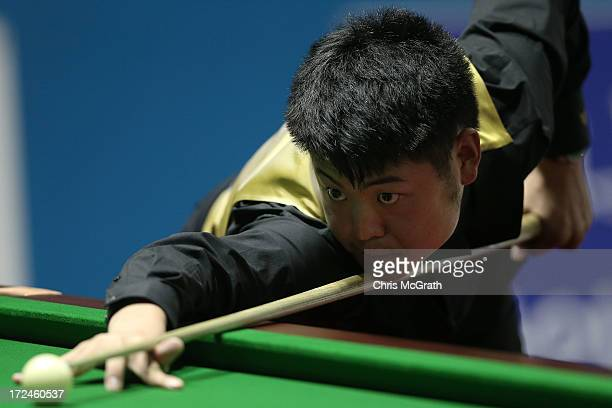 Liang Wenbo of China plays a shot during the Billiards Men's Team Gold Medal Match between China and Independent Olympic Athletes at Songdo Convensia...
