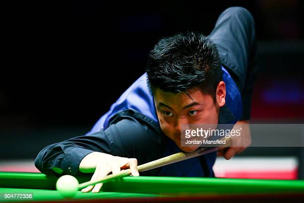 Liang Wenbo of China plays a shot in his first round match against John Higgins of Scotland during Day Four of the Dafabet Masters at Alexandra...