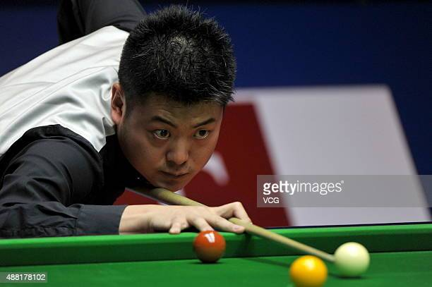 Liang Wenbo of China plays a shot in the match against John Higgins of Scotland during day one of the Shanghai Masters 2015 at Shanghai Grand Stage...