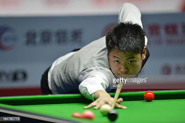 Liang Wenbo of China plays a shot in the match against Stuart Bingham of England during day three of the 2013 World Snooker China Open at Beijing...
