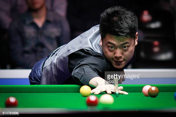 Liang Wenbo of China plays a shot in the quarterfinals against Anthony Hamilton of England on day five of the Coral English Open 2016 at Event City...