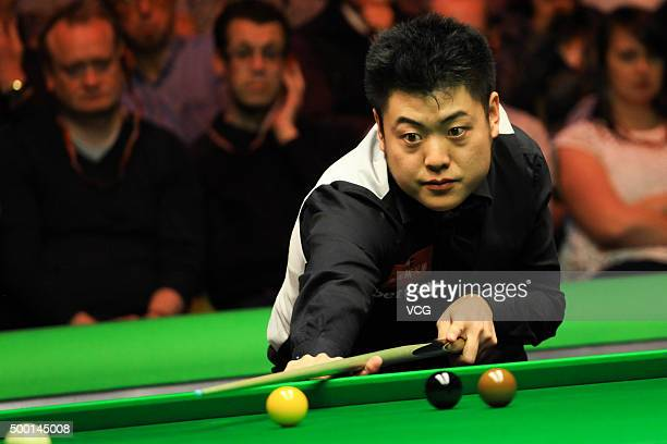 Liang Wenbo of China plays a shot in the semifinal match against David Grace of England on day 11 of Betway UK Championship at Barbican Centre on...