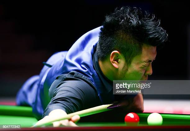 Liang Wenbo of China reacts after a missed shot in his first round match against John Higgins of Scotland during Day Four of the Dafabet Masters at...