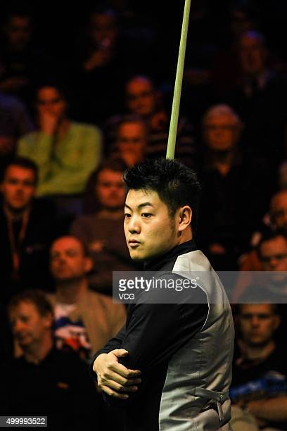 Liang Wenbo of China reacts against Marco Fu of Hong Kong in quarterfinal match on day ten of Betway UK Championship at Barbican Centre on December 4...