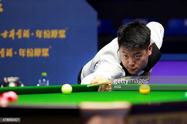 Liang Wenbo of China reacts against Mark Selby of England on day four of the 2014 Snooker Haikou World Open on March 13 2014 in Haikou Hainan...