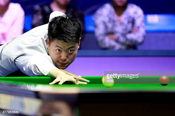 Liang Wenbo of China reacts against Scott Donaldson of Scotland on day two of the 2014 Snooker Haikou World Open on March 11 2014 in Haikou China