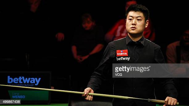 Liang Wenbo of China reacts against Tom Ford of England in fourth round match on day nine of Betway UK Championship at Barbican Centre on December 3...