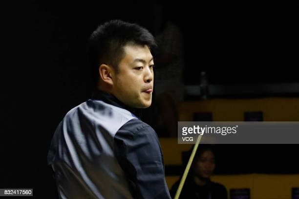 Liang Wenbo of China reacts during a qualifying match against Ian Burns of England on day one of Evergrande 2017 World Snooker China Champion at...