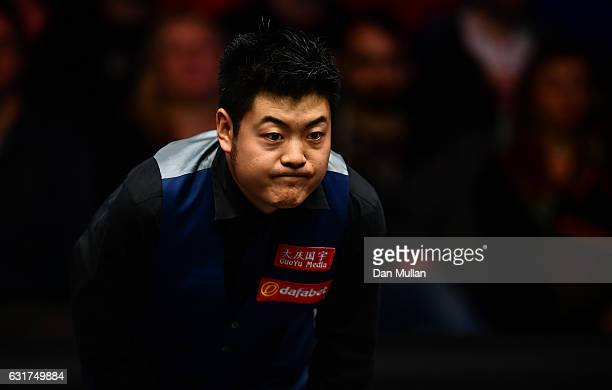 Liang Wenbo of China reacts during his first round match against Ronnie O'Sullivan of England on day one of the Dafabet Masters at Alexandra Palace...