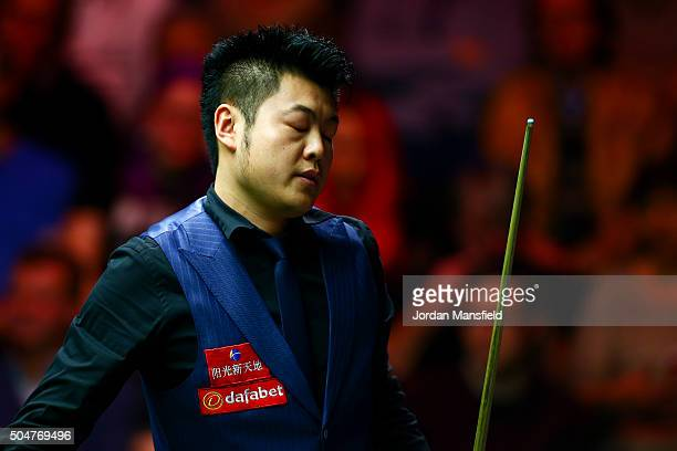 Liang Wenbo of China reacts in his first round match against John Higgins of Scotland during Day Four of the Dafabet Masters at Alexandra Palace on...
