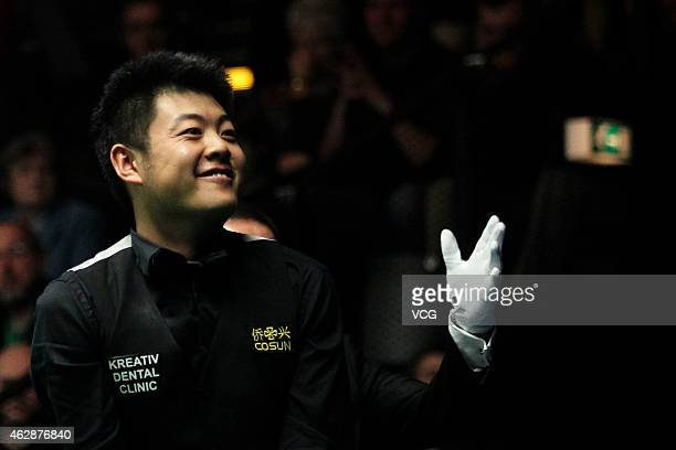 Liang Wenbo of China smiles after winning his match against Ryan Day of Great Britain on day three of the 2015 German Masters at Tempodrom on...
