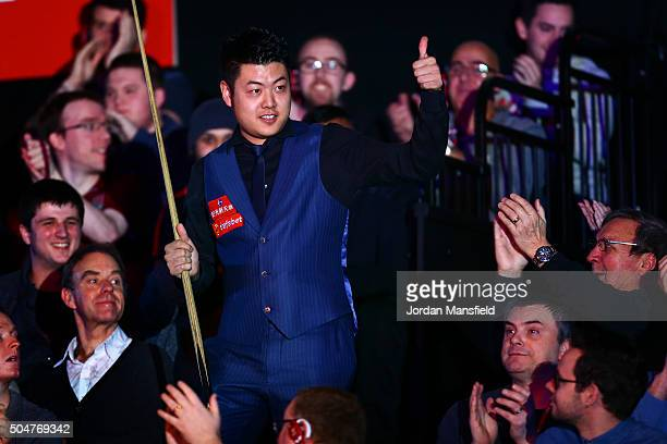 Liang Wenbo of China walks in ahead of his first round match against John Higgins of Scotland during Day Four of the Dafabet Masters at Alexandra...