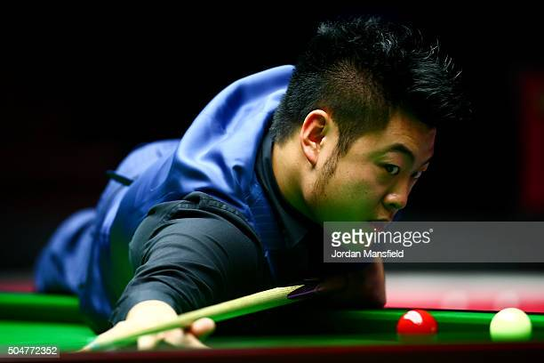 Liang Wenbo of China watches on a shot in his first round match against John Higgins of Scotland during Day Four of the Dafabet Masters at Alexandra...