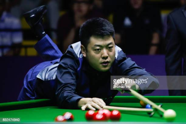 Liang Wenbo plays a shot against Ian Burns during the Evergrande 2017 World Snooker China Championship on August 16 2017 in Guangzhou China