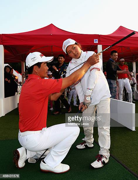Liang WenChong coaches local children during a CGAHSBC Junior Program Clinic ahead of the WGC HSBC Champions at the Sheshan International Golf Club...