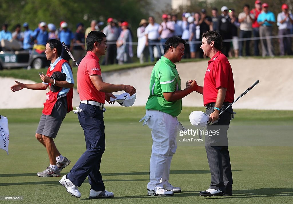 Liang Wenchong of China and Kiradech Aphibarnrat of Thailand congratulate Thomas Aiken of South Africa on his victory during day four of the Avantha Masters at Jaypee Greens Golf Club on March 17, 2013 in Delhi, India.