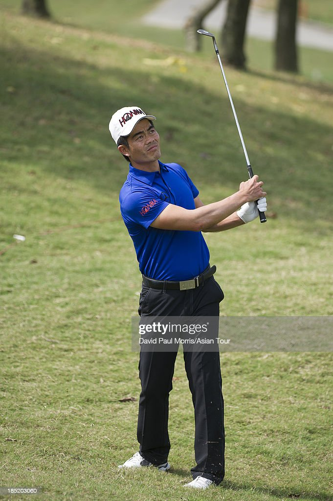 Liang Wen-chong of China hits his approach shot to the 7th green during round two of the Venetian Macau Open on October 18, 2013 at the Macau Golf & Country Club in Macau. The Asian Tour tournament offers a record US$ 800,000 prize money which goes through October 20.