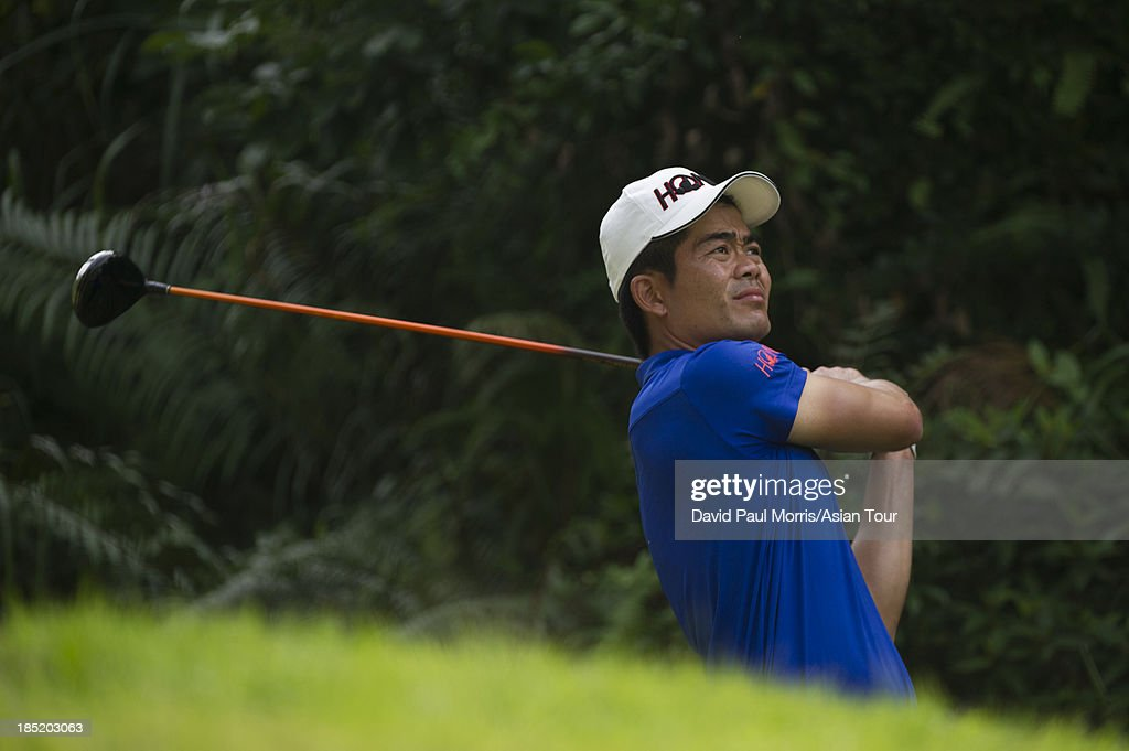 Liang Wen-chong of China hits his drive on the 8th hole during round two of the Venetian Macau Open on October 18, 2013 at the Macau Golf & Country Club in Macau. The Asian Tour tournament offers a record US$ 800,000 prize money which goes through October 20.