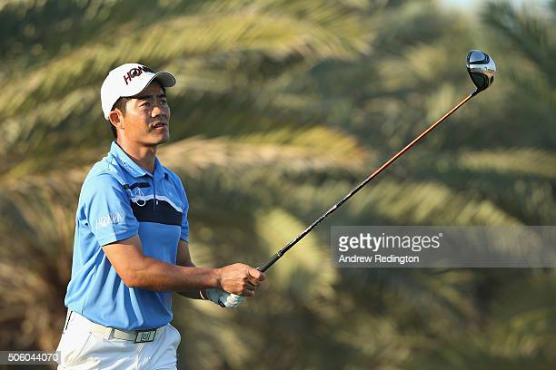 Liang wenchong of China hits his teeshot on the 14th hole during the first round of the Abu Dhabi HSBC Golf Championship at the Abu Dhabi Golf Club...
