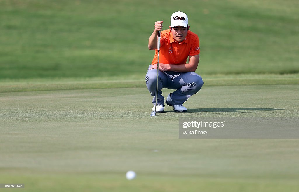 Liang Wenchong of China lines up a putt during day three of the Avantha Masters at Jaypee Greens Golf Club on March 16, 2013 in Delhi, India.