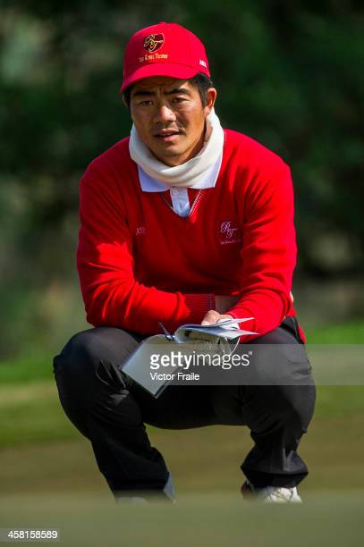 Liang Wenchong of China lines up a putt on at the 10th hole during the Royal Trophy Europe vs Asia Championship at the Dragon Lake Golf Club on...